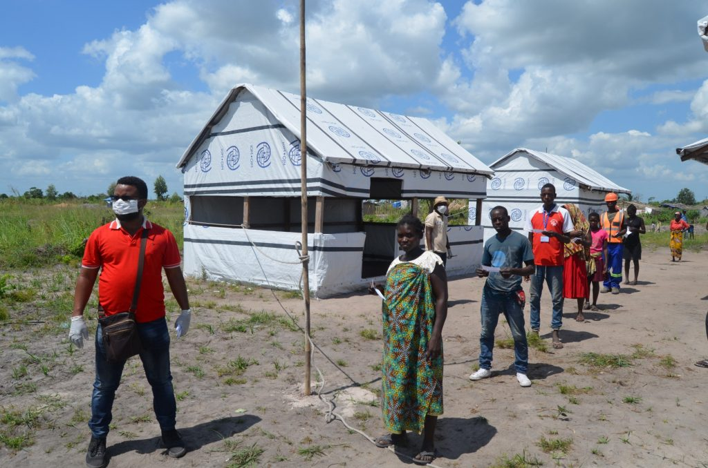 Mozambique: Recipients of food assistance are divided into smaller groups and asked to stay 1.5 metres apart. Photo: WFP/Rafael Campos